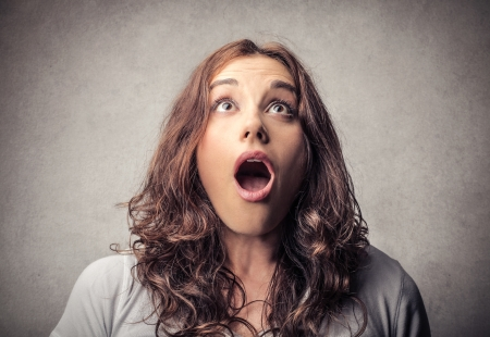 Surprise: astonished young woman  Stock Photo