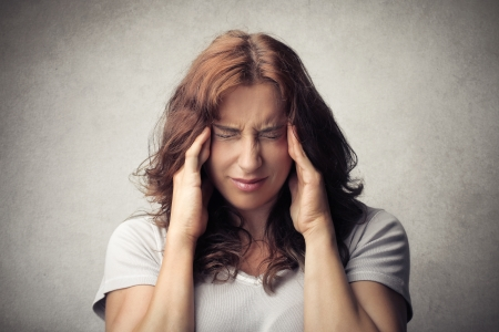 woman headache: young woman with headache