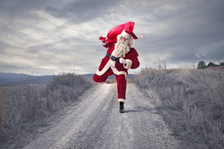 Santa Klaus running on a path