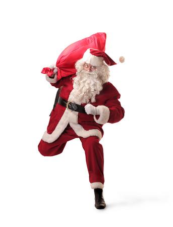 Santa Klaus running with a red bag