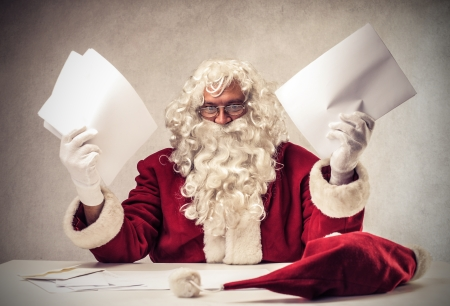 christmas list: Desperate Santa Klaus with lots of letters Stock Photo