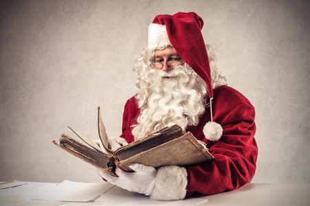 Santa Klaus reading a book