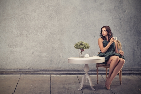 table and chairs: young beautiful woman waiting sitting on a chair