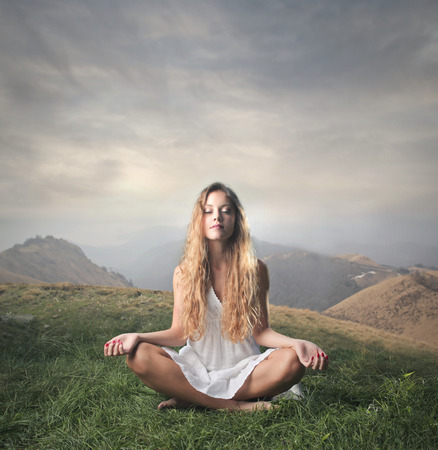 young woman meditating  photo