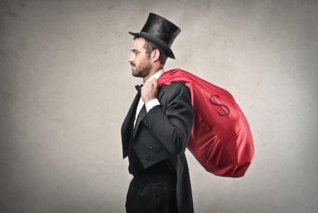 ironic: rich man with a red bag full of money Stock Photo
