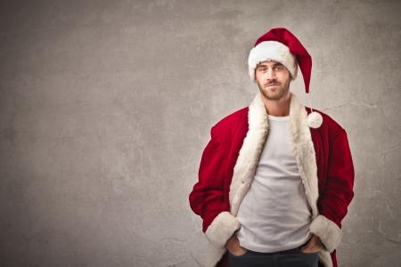 サンタ クロースの服を着た男 写真素材
