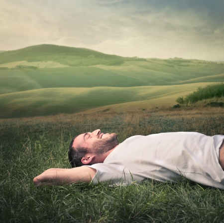 meadows: man relaxing on the grass