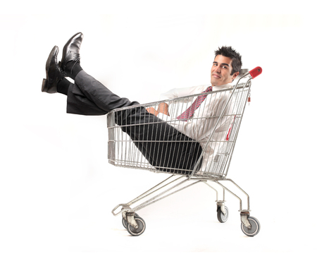 businessman relaxing into a cart photo