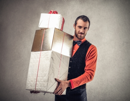 handsome man holding presents photo