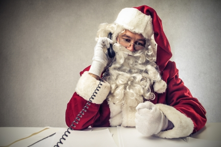 Santa Klaus on the phone Stock Photo - 22756642