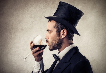 rich man drinking wine photo