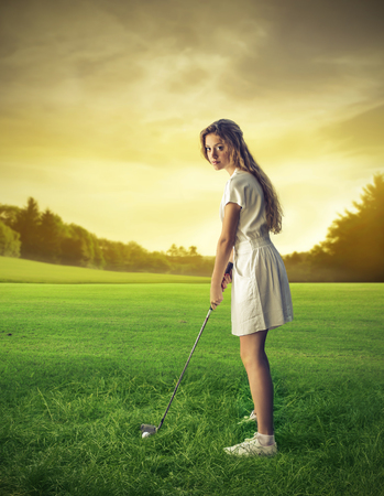 snob: young woman playing golf Stock Photo