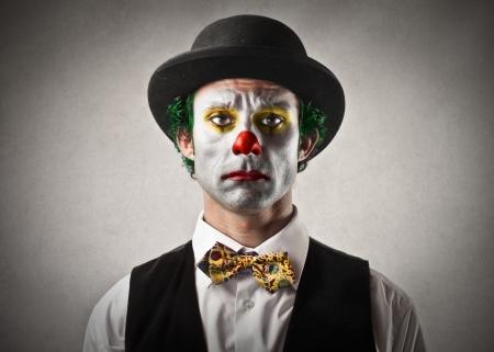 sad people: sad bored clown