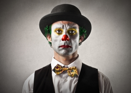 upset man: sad bored clown