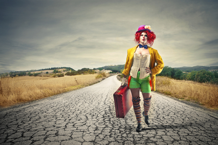 clown leaving with her suitcase Stock Photo - 22756721