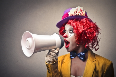 clown speaking through a megaphone