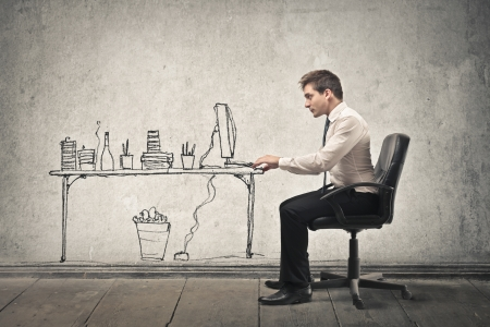 immagination: businessman working on a drawn computer