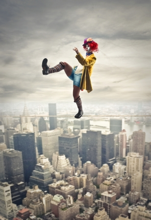 ironic: clown on the top of the city Stock Photo