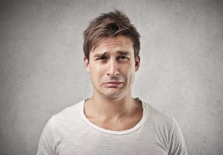 sad faces: sad man  Stock Photo
