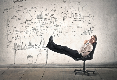 businessman relaxing on a chair Stock Photo