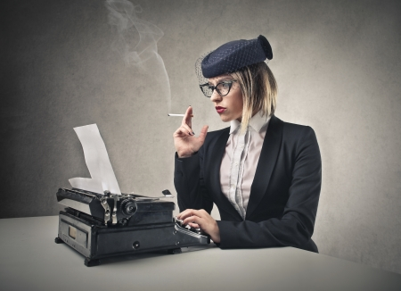 woman typing and smoking  photo