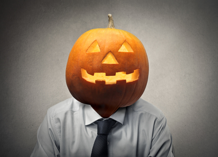 businessman with a pumpkin head