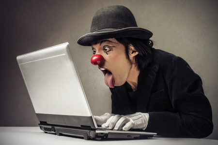 clown looking at a laptop photo