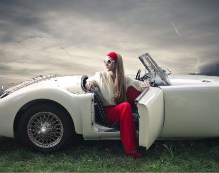 ladies: beautiful fashion woman on a car