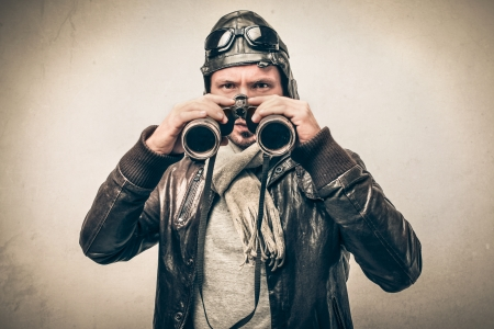 appealing attractive: handsome attractive aviator looking with a binoculars