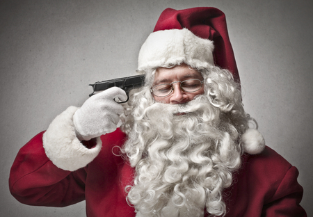 Santa Klaus about to shoot himself