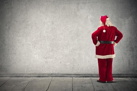 santa: Santa Klaus looking at a wall Stock Photo