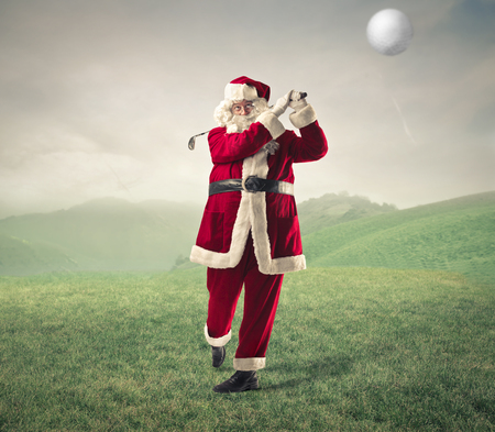 christmas costume: Santa Klaus playing golf