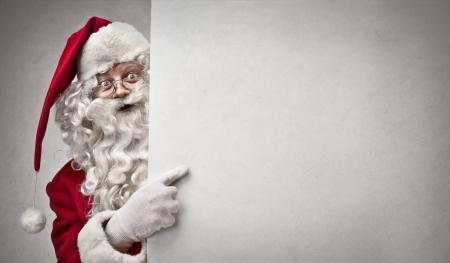 Santa Klaus showing something photo