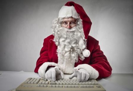 Santa Klaus typing  photo
