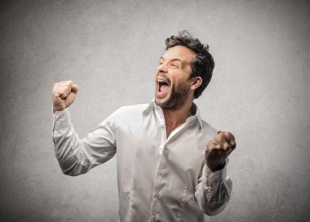 jubilate: man cheering  Stock Photo