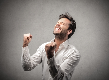 happy: man cheering  Stock Photo