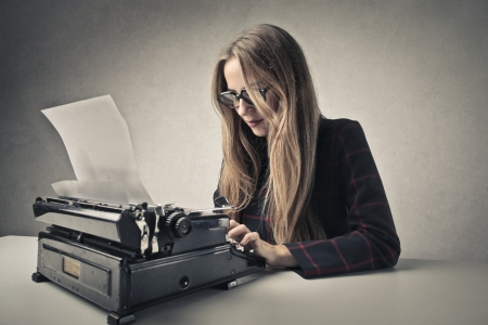 woman typing: young business woman typing