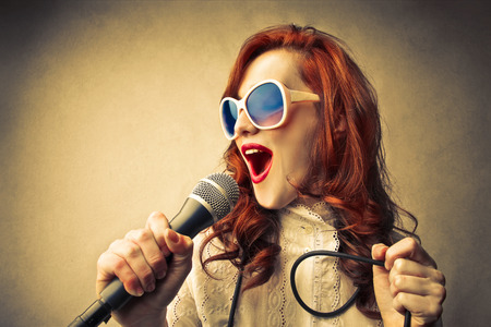 woman is about to sing  Stock Photo