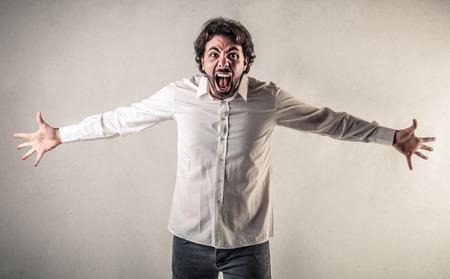yelling man Standard-Bild