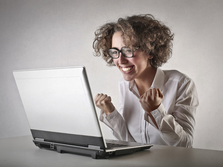 fun woman in front of her computer