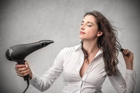 phono: lady with her hairdryer