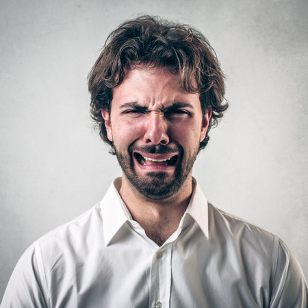 despaired: man with crying face