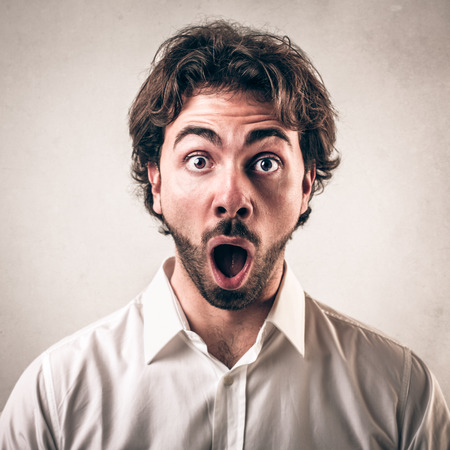 neutral face: shocked face guy  Stock Photo