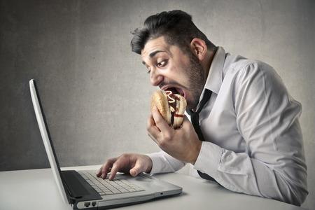 junky: man eating hamburger Stock Photo