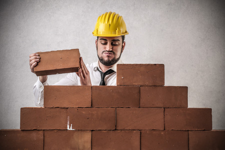 snort: worker building something  Stock Photo