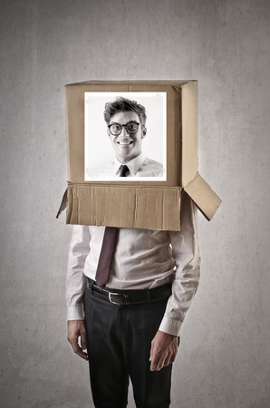 hiding face: in the box Stock Photo
