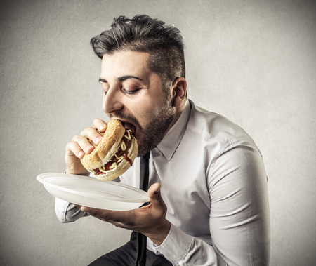 junky: eating businessman Stock Photo