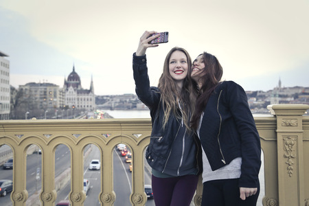 friend hug: taking a selfie Stock Photo