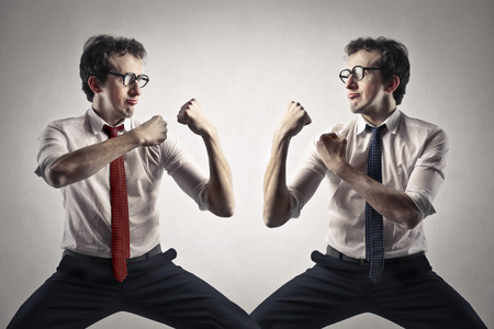 fist fight: fighting businessman Stock Photo