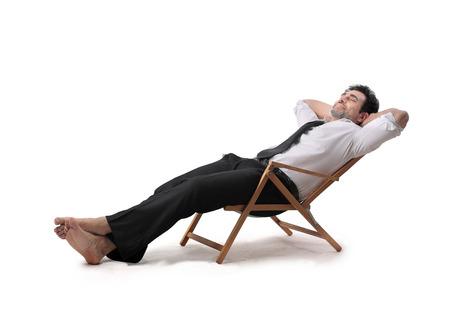 deitado: empresário relaxante Imagens